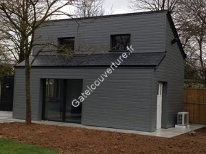 Création d'un abris jardin en ossature bois avec couverture ardoise naturelle et bardage bois
